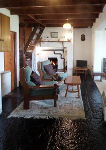 Traditional cottage sitting room with solid fuel stove